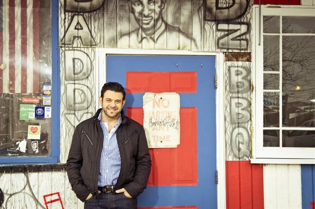 This undated photo provided by the Travel Channel shows host Adam Richman of the new series,