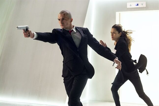 This photo released by Twentieth Century Fox shows, Rupert Friend, left, as Agent 47, and Hannah Ware as Katia, in a scene from the film,