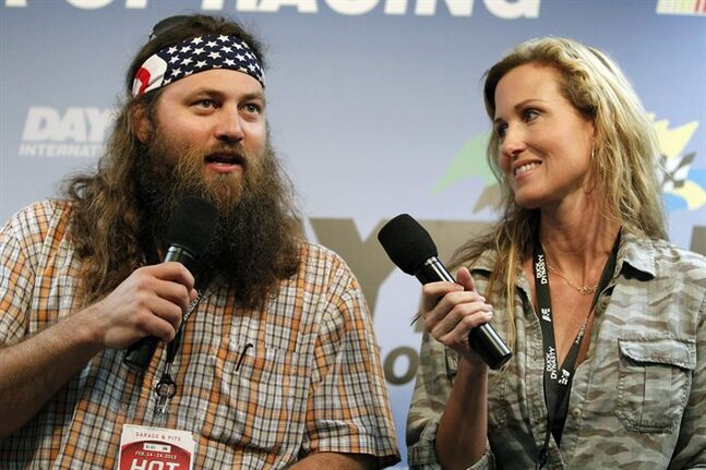 FILE - This Feb. 24, 2013 file photo shows Willie Robertson, left, and Korie Robertson, of the reality TV show,
