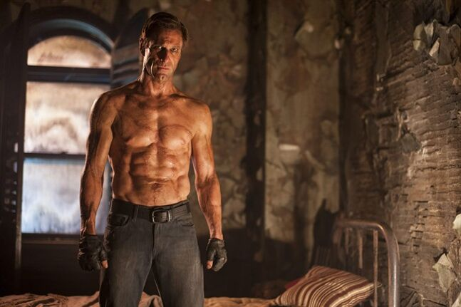 This image released by Lionsgate shows Aaron Eckhart in a scene from the film,