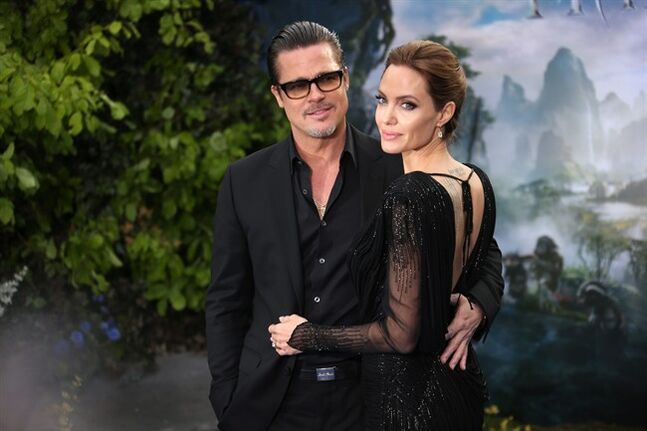 In this Thursday, May 8, 2014 file photo, actors Brad Pitt and Angelina Jolie arrive for the