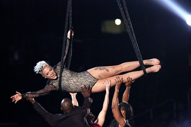 FILE - In this Jan. 26, 2014 file photo, Pink performs at the 56th annual Grammy Awards at Staples Center, in Los Angeles. Producers of the 86th Academy Awards announced Friday, Feb. 21, 2014, that Pink will appear on the Oscar show. The Grammy-winning singer joins a lineup already set to include performances from U2, Pharrell Williams, Bette Midler, rocker Karen O and Broadway star Idina Menzel. (Photo by Matt Sayles/Invision/AP, file)