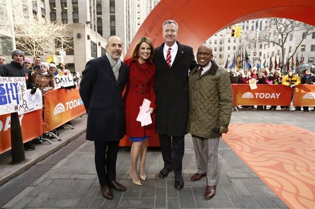 This Monday, Feb. 24, 2014 photo released by NBC shows, from left, Matt Lauer, Savannah Guthrie, Mayor Bill De Blasio, and Al Roker on NBC's