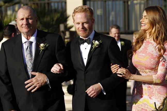 This photo released by ABC shows, from left, Ed O'Neill, Jesse Tyler Ferguson and Sofia Vergara, in the season finale,