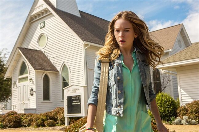 This undated publicity photo released by CBS Entertainment shows Britt Robertson, as Angie, in a scene from the pilot of the TV series