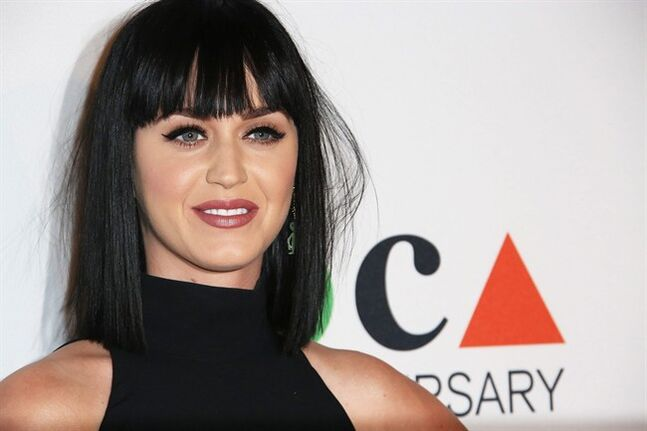 FILE - In this Saturday, March 29, 2014 file photo, Katy Perry arrives at MOCA's 35th Anniversary Gala presented by Louis Vuitton at The Geffen Contemporary at MOCA, in Los Angeles. Perry stops by Staples Center on Thursday, June 12, 2014, to announce her support for teachers. (Photo by Annie I. Bang /Invision/AP, file)