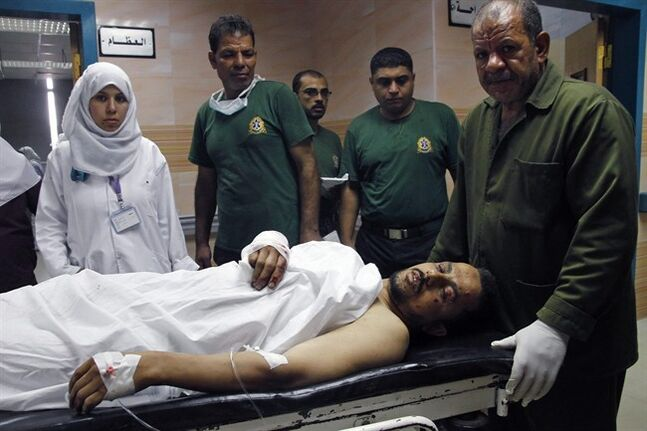 Nurses rush an injured man into a hospital following an explosion at a subway station, in Cairo, Egypt, Wednesday, June 25, 2014. Four minor explosions struck subway stations in Cairo on Wednesday, wounding many people and causing widespread panic among morning commuters, officials said. (AP Photo/Magdy Ebrahim, El Shorouk Newspaper) EGYPT OUT