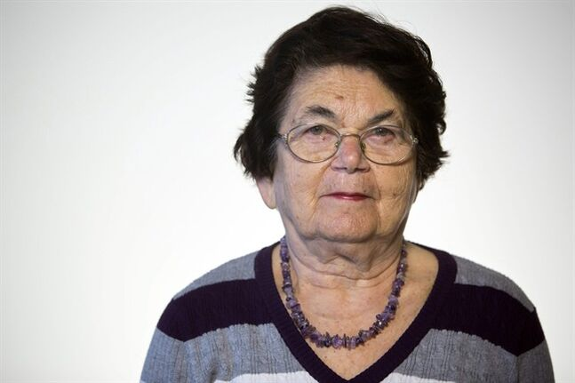 In this photo taken Wednesday, April 9, 2014, Israeli Holocaust survivor Ester Koffler Paul, 82, originally from what is now Ukraine, poses for a portrait in Jerusalem. When she thinks back on her Holocaust ordeal, she mostly remembers her sister. Paul was 8, and her sister Nunia was 10 in 1941, when the Nazis invaded their hometown of Buchach in what is now Ukraine. Their mother died before the war and their father was taken by the Nazis and murdered along with 700 other Jewish men. (AP Photo/Sebastian Scheiner)