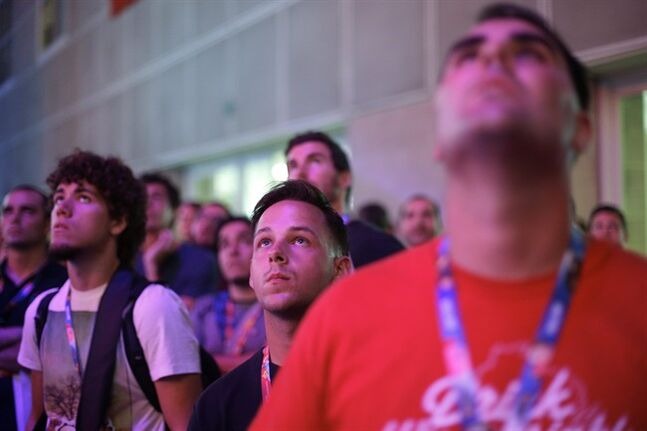 Show attendees watch gamers play the video game