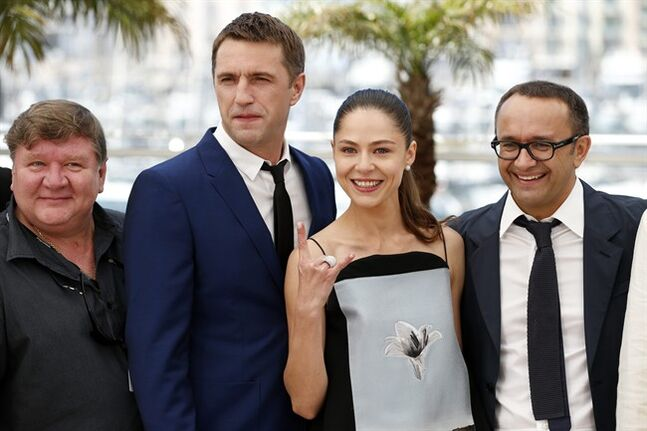 From left, actor Roman Madianov, actor Vladimir Vdovichenkov, actress Elena Lyadova, and director Andrey Zvyagintsev during a photo call for Leviathan at the 67th international film festival, Cannes, southern France, Friday, May 23, 2014. (AP Photo/Alastair Grant)