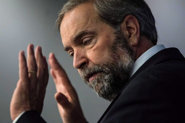 Federal NDP Leader Thomas Mulcair speaks to the Toronto Region Board of Trade on June 20, 2014. Prime Minister Stephen Harper has taken a chopper tour of flood-stricken southern Manitoba but apparently his government doesn't see any need for NDP Leader Tom Mulcair to see the disaster zone for himself. THE CANADIAN PRESS/Chris Young