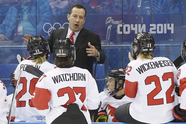 Canada head coach Kevin Dineen talks to the team during a break in the action against Switzerland in the first period of the 2014 Winter Olympics women's semifinal ice hockey game at Shayba Arena, Monday, Feb. 17, 2014, in Sochi, Russia. Dineen, who coached Canada's women's hockey team to a gold medal at the Sochi Olympics, has returned to the NHL as an assistant with the Chicago Blackhawks. THE CANADIAN PRESS/AP/Mark Humphrey