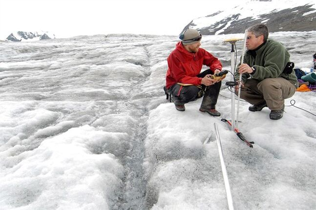 PhD student Matt Beedle (left) and professor Brian Menounos measure changes in glacier thickness using GPS in this undated handout photo. THE CANADIAN PRESS/HO, University of Northern British Columbia