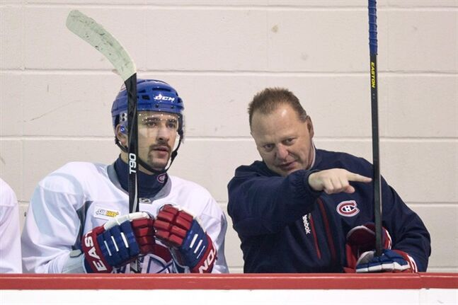 Montreal Canadiens Tomas Plekanec gets a few pointers from assistant coach Gerard Gallant during their training camp Wednesday, January 16, 2013 in Brossard, Que. The Florida Panthers have hired Gerard Gallant as coach, reuniting him with standout Jonathan Huberdeau THE CANADIAN PRESS/Paul Chiasson