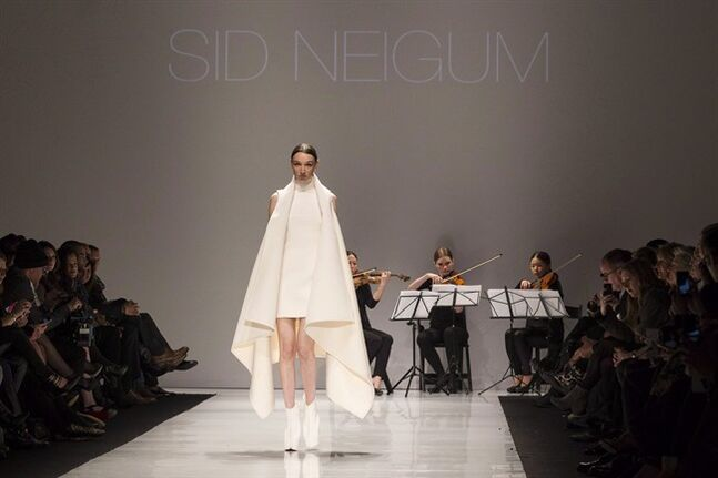 A model shows a creation from Sid Neigum while walking the runway during Toronto Fashion Week in Toronto on Monday March 17, 2014. Neigum is one of the finalists in the Mercedes-Benz Start Up program for emerging designers who will be vying to win a $30,000 bursary. THE CANADIAN PRESS/Chris Young