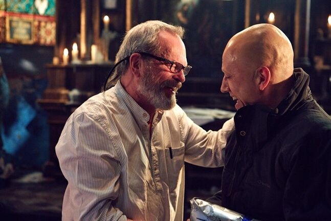 Terry Gilliam (left) and Christoph Waltz talk on the set of The Zero Theorem in a handout photo. THE CANADIAN PRESS/ HO-Mongrel Media