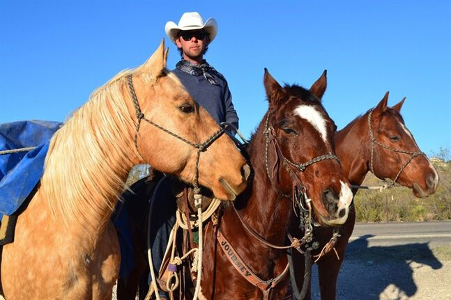 Filipe Masetti Leite rides into Carlsbad, N.M. on Nov. 29, 2012. A Canadian cowboy who completed a 16,000 km horseback journey from Calgary to Brazil said he was overcome with emotion at trail's end. THE CANADIAN PRESS/AP, Carlsbad Current-Argus, Natalie Gross
