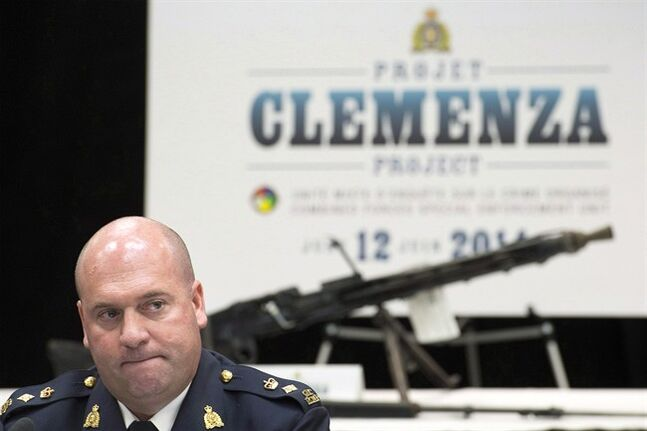 RCMP officer Michel Arcand speaks to reporters about an anti-Mafia bust during a news conference at RCMP headquarters in Montreal, Thursday, June 12, 2014. The RCMP are apologizing for the code name used to describe its latest anti-Mafia bust in Quebec. THE CANADIAN PRESS/Graham Hughes