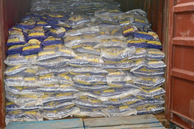 A sea container containing over 500 sacks of rice is pictured in a handout photo released on Thursday August 7, 2014. THE CANADIAN PRESS/HO, RCMP