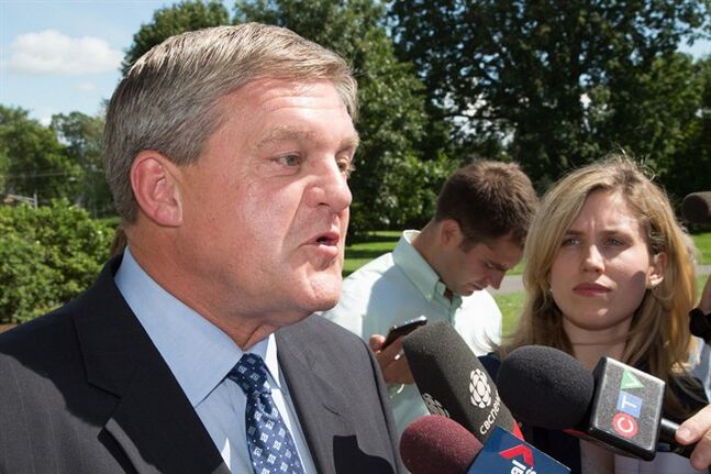 New Brunswick Premier David Alward speaks to reporters after his meeting with Lt.-Gov. Graydon Nicholas in Fredericton, N.B., on Monday, August 18, 2014. Premier Alward met with Lt. Gov. Nicholas to ask for the legislative assembly to be dissolved ahead of next month's provincial election. THE CANADIAN PRESS/Keith Minchin