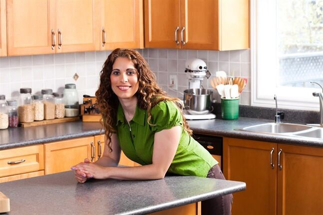 Emily Richards, a busy mother of three, says the trick to serving your family a different tasty dinner each weeknight is to incorporate similar ingredients and cooking techniques throughout the week but put a different spin on them each day. The Guelph, Ont.-based professional home economist, shown in a handout photo, is also a recipe developer for Longo's.THE CANADIAN PRESS/HO