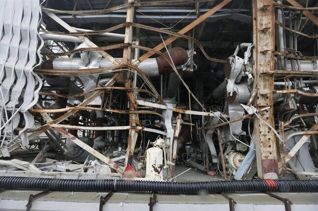 The damaged Unit 4 reactor building at the Fukushima Dai-ichi nuclear power plant is seen in Okuma town, Fukushima prefecture, northeastern Japan in a Nov.7, 2013 file photo. Canada's nuclear watchdog for the first time is proposing that people living near reactors be given a precautionary stock of radiation-fighting pills in case of an accident. The Canadian Nuclear Safety Commission has been reviewing the country's emergency preparedness and response regulations in the wake of the meltdown at Japan's Fukushima reactor in 2011. THE CANADIAN PRESS/AP/Kimimasa Mayama