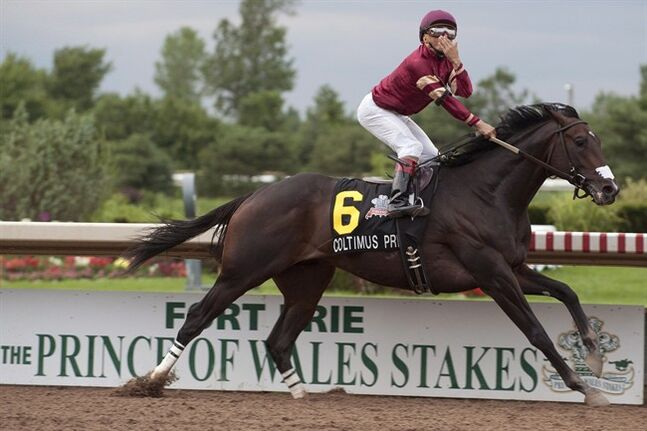Coltimus Prime Jockey Eurico Da Silva blows a kiss after going wire to wire to capture the $500,000 dollar Prince of Wales stakes in Fort Erie, Ontario on Tuesday Jukly 29, 2014. THE CANADIAN PRESS/michael burns