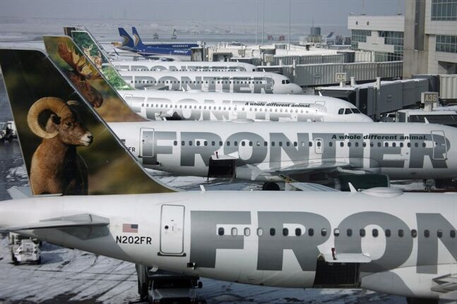 Frontier Airlines jetliners sit at gates at Denver International Airport on Feb. 22, 2010. THE CANADIAN PRESS/AP, David Zalubowski