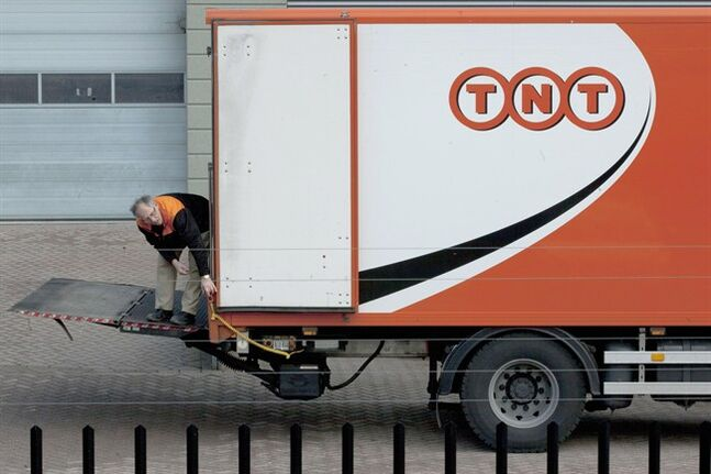 A TNT employee operates a delivery truck in Hoofddorp, near Amsterdam, on Feb. 21, 2012. THE CANADIAN PRESS/AP, Peter Dejong
