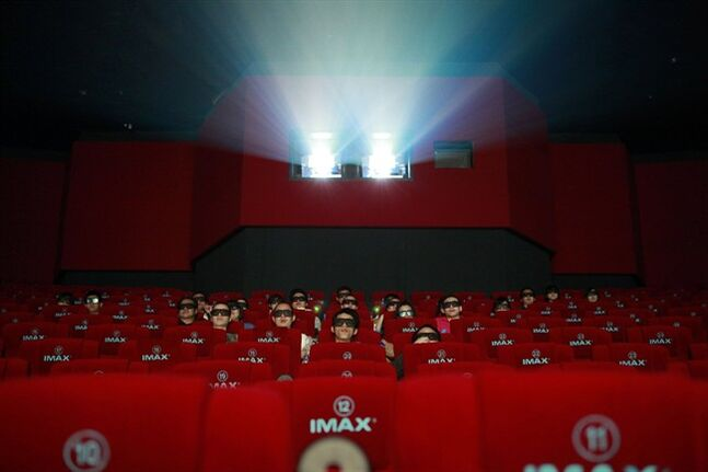 Patrons watch a 3D IMAX movie at a theater in Beijing, May 21, 2012. THE CANADIAN PRESS/AP, Ng Han Guan