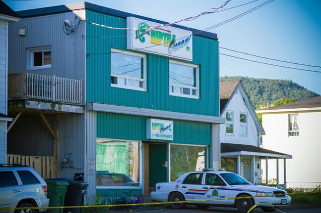 An RCMP cruiser sits outside the Reptile Ocean exotic pet store in Campbellton, N.B., in a August 6, 2013 photo. THE CANADIAN PRESS/John LeBlanc