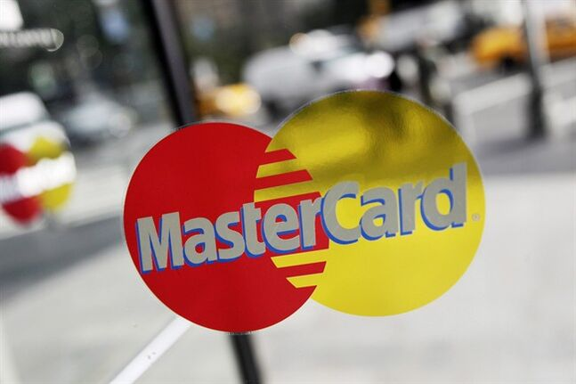 A MasterCard sign is pictured on a revolving door in New York on Sept. 21, 2011. THE CANADIAN PRESS/AP, Mark Lennihan