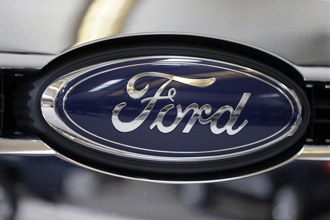 A Ford logo on the grill of a 2013 Ford F-350 truck in Pittsburgh on Feb. 14, 2013. Ford reports quarterly financial results on Thursday, July 24, 2014.THE CANADIAN PRESS/AP, Gene J. Puskar