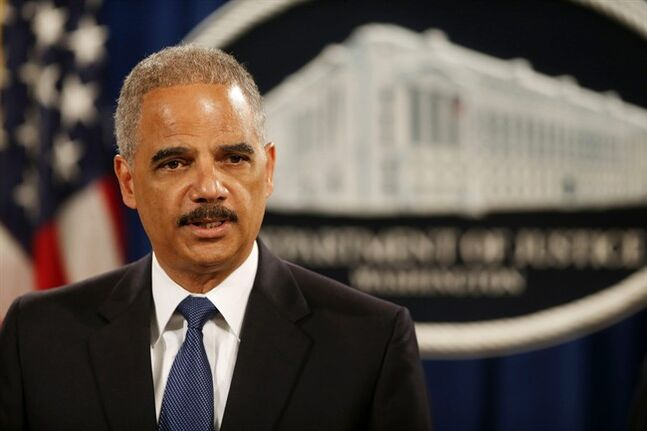 Attorney General Eric Holder speaks at a news conference at the Justice Department in Washington, Monday, May 19, 2014. Holder announced that a U.S. grand jury has charged five Chinese hackers with economic espionage and trade secret theft, the first-of-its-kind criminal charges against Chinese military officials in an international cyber-espionage case. (AP Photo/Charles Dharapak)