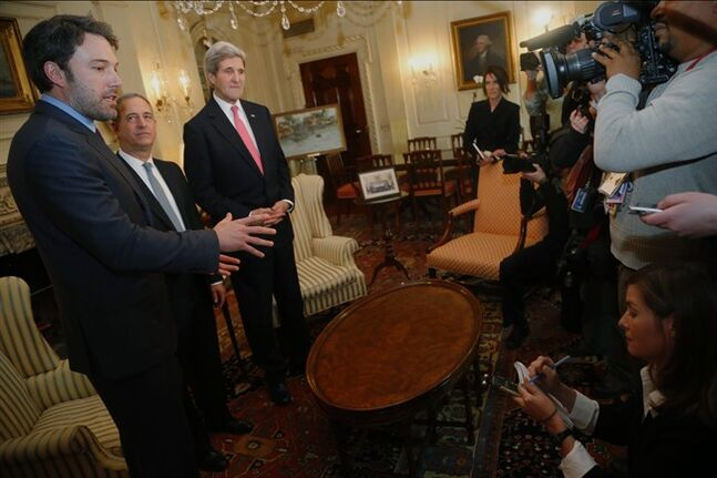 Actor Ben Affleck, left, answers a reporter's question as US Special Envoy for the Great Lakes Region of Africa Russ Feingold, center, and Secretary of State John Kerry listen during a photo opportunity before their meeting about Congo, Wednesday, Feb. 26, 2014, at the State Department in Washington. (AP Photo/Charles Dharapak)