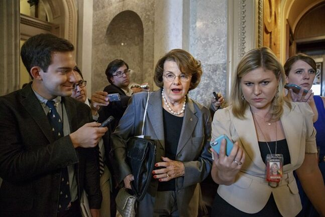 Senate Intelligence Committee Chair Sen. Dianne Feinstein, D-Calif.,speaks to reporters on Capitol Hill in Washington, Tuesday, June 17, 2014, after a Democratic caucus. President Barack Obama will meet with Congressional leaders at the White House on Wednesday to discuss the turmoil in Iraq. (AP Photo/J. Scott Applewhite)