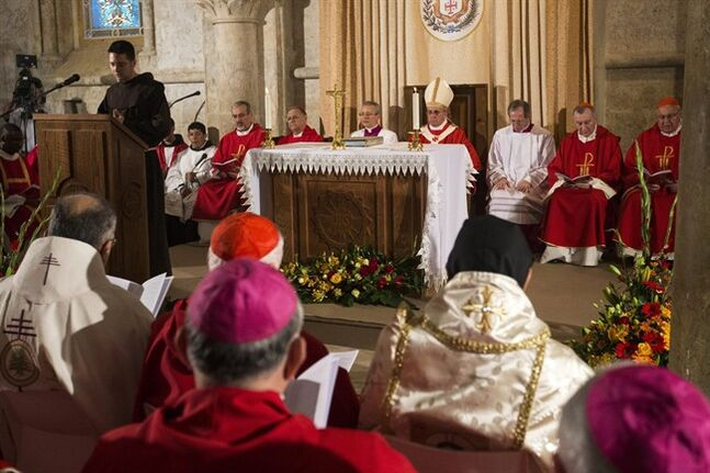 Pope Francis, center, attends a mass at the site known as the Cenacle, or Upper Room, where Christians believe Jesus had his last supper, in Jerusalem on Monday, May 26, 2014. Francis honored Jews killed in the Holocaust and other attacks and kissed the hands of Holocaust survivors as he capped his three-day Mideast trip with poignant stops Monday at some of the holiest and most haunting sites for Jews. (AP Photo/Jack Guez, Pool)