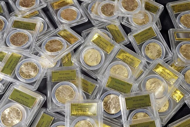 FILE - This Feb. 25, 2014 file photo shows some of the 1,427 Gold-Rush era U.S. gold coins displayed at Professional Coin Grading Service in Santa Ana, Calif. A treasure trove of rare gold coins discovered by a California couple out walking their dog is set to go on sale on Tuesday, May 27, 2014. (AP Photo/Reed Saxon, File)