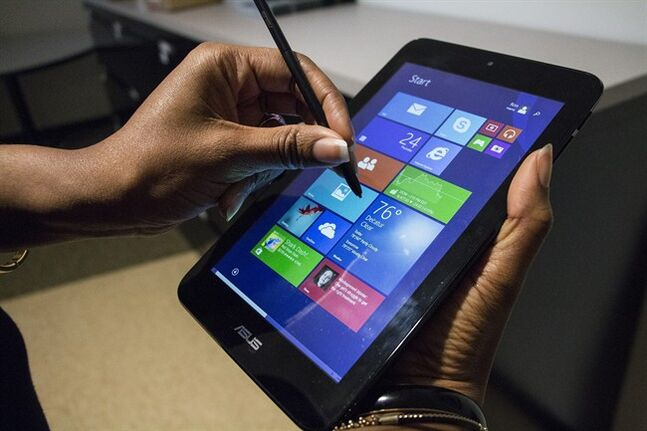 This April 24, 2014 shows the ASUS VivoTab Note 8 tablet computer, in Atlanta. The Note 8 runs a full version of Microsoft's Windows 8 operating system and comes with a Wacom stylus pen for use with the screen that has 1024 levels of pressure sensitivity. (AP Photo/Ron Harris)