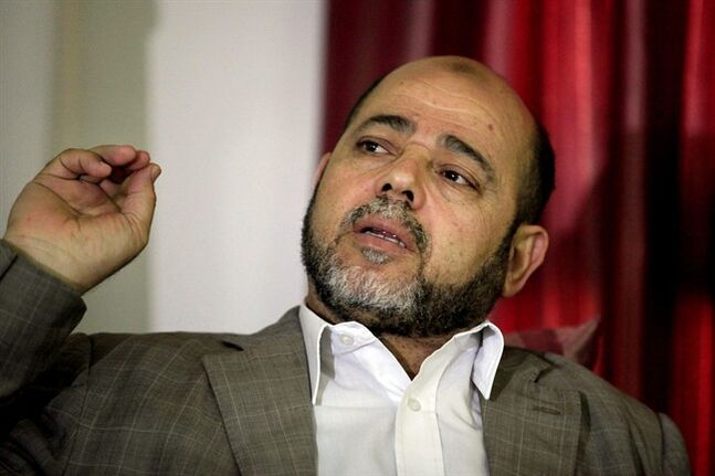 Senior Hamas leader Moussa Abu Marzouk speaks during an interview with the Associated Press in Gaza City, Tuesday, June 10, 2014. The No. 2 in Hamas, Abu Marzouk, says he hopes to move from his base in Egypt to his native Gaza Strip following the formation of a Palestinian unity government last week. Abu Marzouk said reconciliation efforts between his Islamic militant movement and Palestinian President Mahmoud Abbas have been bumpy. (AP Photo/Hatem Moussa)