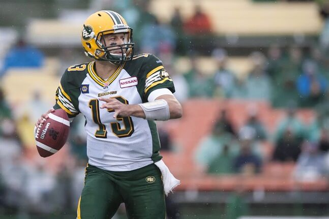 Edmonton Eskimos quarterback Mike Reilly looks to make a pass against the Saskatchewan Roughriders during the first quarter of CFL pre-season football action at Mosaic Stadium on Friday, June 20, 2014 in Regina. Reilly is staying put.The Edmonton Eskimos signed their starting quarterback to a contract extension through the 2016 season Monday. THE CANADIAN PRESS/Liam Richards