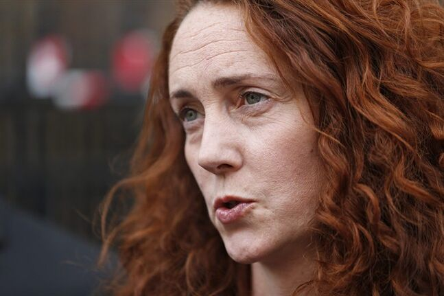 Rebekah Brooks, former News International chief executive, talks to members of the media in central London, Thursday, June 26, 2014. Brooks was acquitted after a long trial centering on illegal activity at the heart of Rupert Murdoch's newspaper empire but Former News of the World editor Andy Coulson was convicted of phone hacking. The nearly eight-month trial was triggered by revelations that for years the News of the World used illegal eavesdropping to get stories, listening in on the voicemails of celebrities, politicians and even crime victims. (AP Photo/Lefteris Pitarakis)