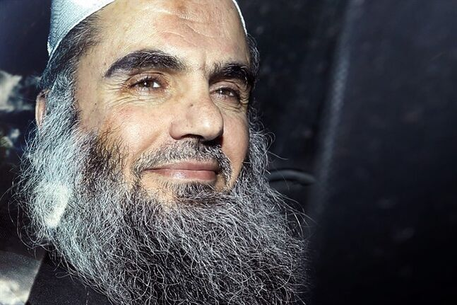 FILE - This is a Tuesday, April 17, 2012 file photo, of radical Islamist cleric Abu Qatada as he is driven away after being refused bail at a hearing at in London. A Jordanian military court on Thursday June 26, 2014 acquitted al-Qaida-linked preacher Abu Qatada of terrorism charges over a foiled 1999 plot to attack an American school (AP Photo/Matt Dunham, File)
