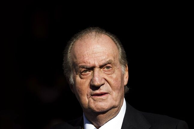 FILE - In this Tuesday, Dec. 27, 2011 file photo, Spain's King Juan Carlos leaves after the official opening of the Parliament, in Madrid. Spain's royal palace says King Juan Carlos will undergo surgery next month for a lower back disc hernia. It will be the 75-year-old monarch's second operation in recent months. He had hip surgery last November. The palace said the king will undergo the hernia operation in a Madrid hospital on Mar. 3, 2013. (AP Photo/Daniel Ochoa de Olza, File)