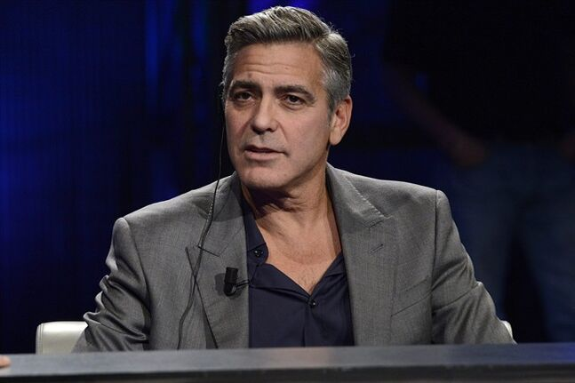 FILE - This Sunday, Feb. 9, 2014 file photo shows American actor George Clooney interviewed by Fabio Fazio during the Italian State RAI TV program