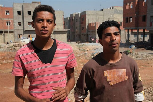 This image released by Kino Lorber, Inc. shows Abdelilah Rachid, left, and Abdelhakim Rachid in a scene from