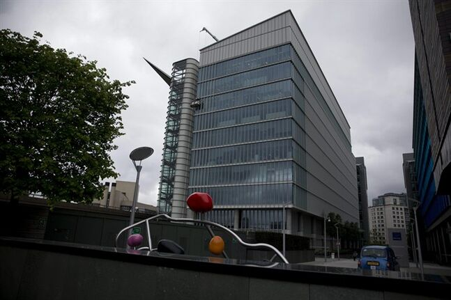 FILE- In this Friday, May 2, 2014 file photo, an exterior view of the Two Kingdom Street building which houses the headquarters of AstraZeneca, in the Paddington area of London. Pfizer Inc. has sought to allay concerns over its proposed $106 billion takeover offer of the Anglo-British firm AstraZeneca, insisting that its promises will be legally binding. In a memo Monday, May 12, 2104 to two parliamentary committees studying its proposed takeover, the U.S. drugmaker laid outs its vision ahead of testimony before the science and business committees. Crucially, the company sought to ease worries that British jobs will be lost and that the nation's science base will be undermined by the potential merger. (AP Photo/Matt Dunham, File)