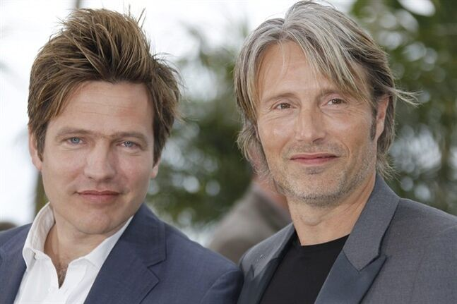 FILE - This is a Sunday, May 20, 2012 file photo of Director Thomas Vinterberg, left, and actor Mads Mikkelsen pose during a photo call for The Hunt at the 65th international film festival, in Cannes, southern France. When Danish director Thomas Vinterberg wrote the script for