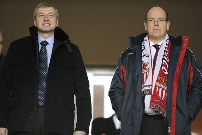 FILE - A Sunday, Jan. 26 , 2014 from files showing President of AS Monaco Dmitry Rybolovlev, left, and Prince Albert II Of Monaco, as they attend the French League One soccer match Monaco vs Marseille, in Monaco stadium. A Swiss court has ordered Russian billionaire Dmitry Rybolovlev to pay $4.5 billion to his ex-wife, in what could end up being the biggest divorce settlement in history. In papers delivered to the parties Monday, May 19, 2014, the Geneva Tribunal of First Instance said the 47-year-old Rybolovlev, a co-owner of the French soccer club AS Monaco, must pay 4,020,555,987.80 Swiss francs ($4,509,375,184.80) to ex-wife Elena Rybolovleva, also 47, of Geneva. The judgment shows that his wife also won two pieces of real estate in the ultra-wealthy area of Geneva known as Cologny, where the couple once lived together, and confirmed her custody of their 13-year-old daughter Anna. They also have an older daughter, Ekaterina, after meeting as university students in Perm, Russia, and marrying there in 1987. The divorce case began in 2008, when Forbes estimated his worth at $12.8 billion. (AP Photo/Lionel Cironneau)