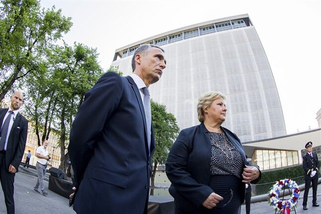 Jens Stoltenberg, Secretary General of NATO, left, and Norwegian Prime Minister Erna Solberg, attend a wreath laying ceremony near the damaged government building in Oslo Tuesday, July 22, 2014, to mark the third anniversary of twin attacks that killed 77 people in Oslo and on Utoeya Island, on July 22, 2011. Solberg said the best way to honor the 77 people who died in terror attacks three years ago is to
